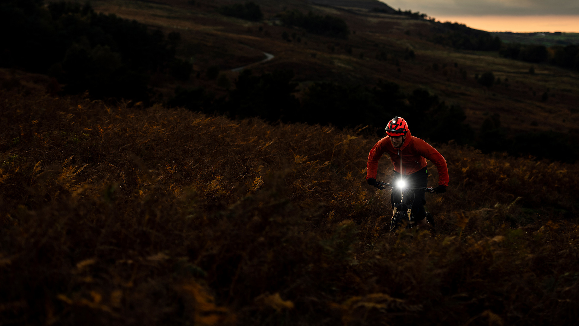 man cycling with front bike light